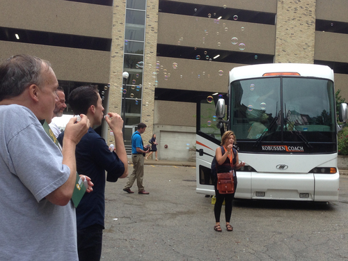 Joseph Klein, left, and Matt Antoncyzk blow bubbles as a bus carrying gay couples and their supporters prepares to depart Monday, Aug. 25, 2014, in Milwaukee. Couples are heading to Chicago to listen to arguments Tuesday before a federal appeals court. (AP Photo/M.L. Johnson)