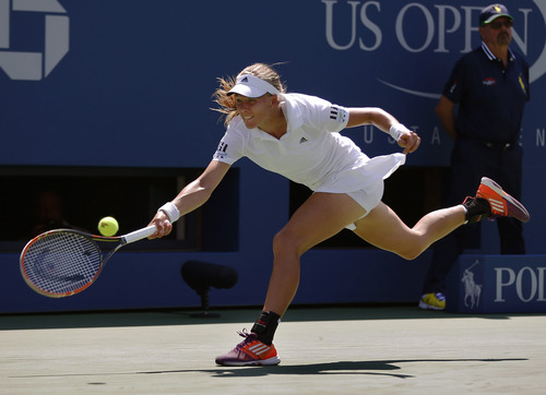 Johanna Larsson, of Sweden, returns a shot against Sloane Stephens, of the United States, during the second round of the 2014 U.S. Open tennis tournament, Wednesday, Aug. 27, 2014, in New York. (AP Photo/Matt Rourke)