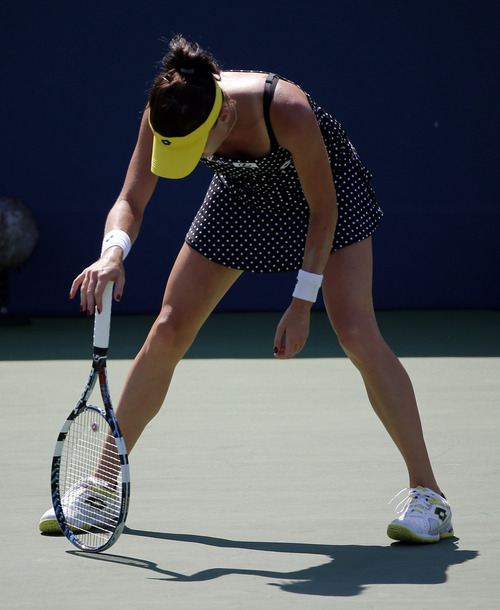 Agnieszka Radwanska, of Poland,of Australia, reacts after losing a point to Shuai Peng, of China, during the second round of the 2014 U.S. Open tennis tournament, Wednesday, Aug. 27, 2014, in New York. (AP Photo/Elise Amendola)
