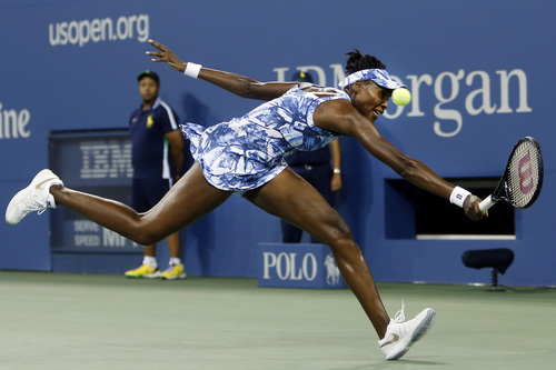 Venus Williams, of the United States, stretches to return a shot to Timea Bacsinszky, of Switzerland, during the second round of the U.S. Open tennis tournament Wednesday, Aug. 27, 2014, in New York. (AP Photo/Jason DeCrow)