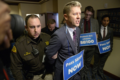 Francisco Kjolseth     Tribune file photo LGBT activist Troy Williams is arrested along with other supporters after blocking the doors to Senate committee room 210 at the Utah state Capitol on Monday, Feb. 9, 2014, in an effort to bring attention to anti-discrimination bill SB100 with hopes of a hearing.