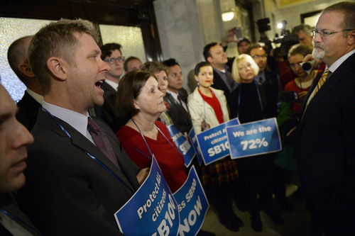 Francisco Kjolseth     Tribune file photo Sen. Stephen Urquhart, R-St. George, far right, meets with LGBT activists Troy Williams, left, and supporters while they block the door to the governor's office at the Capitol on Monday, Feb. 9, 2014, as they demand that anti-discrimination bill SB100 sponsored by Urquhart be heard.
