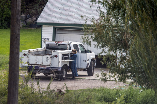 Chris Detrick  |  The Salt Lake Tribune A woman works on Wednesday, Aug. 20, 2014, outside the home near Pocatello, Idaho, where authorities removed nine FLDS boys. Their caretaker, Nathan C. Jessop, has been charged with three misdemeanor counts of child abuse.