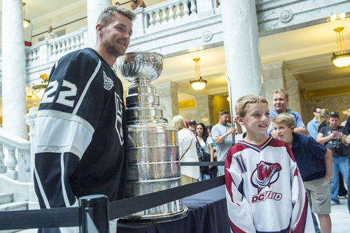 Chris Detrick  |  The Salt Lake Tribune Los Angeles Kings' Trevor Lewis poses for a picture with Brockton Bair, 9, of Syracuse, and the Stanley Cup at the Utah State Capitol Wednesday August 27, 2014. Lewis is a Salt Lake City native who played for Brighton's club team as a freshman in 2002. Hockey tradition dictates that each member of the winning team gets custody of the Cup for one day.