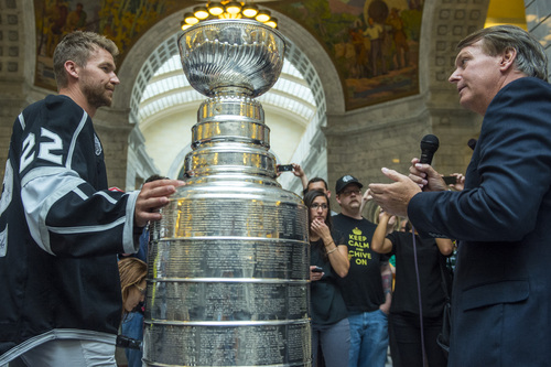 Chris Detrick  |  The Salt Lake Tribune Utah Sports Commission President and CEO Jeff Robbins talks with Los Angeles Kings' Trevor Lewis and the Stanley Cup at the Utah State Capitol Wednesday August 27, 2014. Lewis is a Salt Lake City native who played for Brighton's club team as a freshman in 2002. Hockey tradition dictates that each member of the winning team gets custody of the Cup for one day.