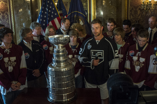 Chris Detrick  |  The Salt Lake Tribune Los Angeles Kings' Trevor Lewis talks with the Viewmont state championship hockey team and the Stanley Cup at the Utah State Capitol Wednesday August 27, 2014. Lewis is a Salt Lake City native who played for Brighton's club team as a freshman in 2002. Hockey tradition dictates that each member of the winning team gets custody of the Cup for one day.