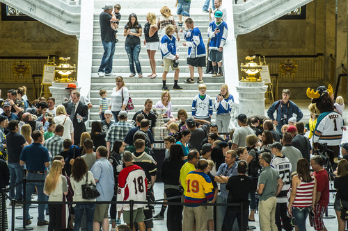 Chris Detrick  |  The Salt Lake Tribune Los Angeles Kings' Trevor Lewis poses for pictures with fans and the Stanley Cup at the Utah State Capitol Wednesday August 27, 2014. Lewis is a Salt Lake City native who played for Brighton's club team as a freshman in 2002. Hockey tradition dictates that each member of the winning team gets custody of the Cup for one day.