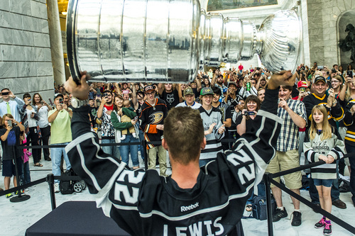 Chris Detrick  |  The Salt Lake Tribune Los Angeles Kingsí Trevor Lewis shows off the Stanley Cup to fans at the Utah State Capitol Wednesday August 27, 2014. Lewis is a Salt Lake City native who played for Brightonís club team as a freshman in 2002. Hockey tradition dictates that each member of the winning team gets custody of the Cup for one day.