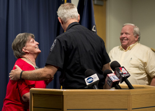 Lennie Mahler  |  The Salt Lake Tribune Shirley England and Jerold Johnson speak with Salt Lake County Sheriff Jim Winder at a press conference after Unified Police solved the 1991 cold-case murder of their mother, Lucille Johnson. Thursday, Aug. 28, 2014.
