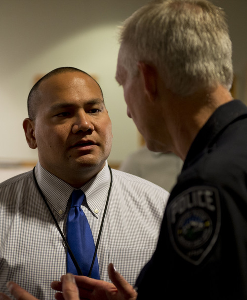 Lennie Mahler  |  The Salt Lake Tribune Detective Mike Ikemiyashiro and Salt Lake County Sheriff Jim Winder speak after a press conference for a solved cold case from 1991. Thursday, Aug. 28, 2014.