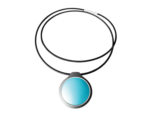 This product image released by Misfit shows the Misfit Shine in topaz attached to a necklace to track activity and sleep data. The waterproof device is equipped with a replaceable battery that can last up to six months, so no charging is required. Luxury fashion is making inroads in wearable tech as more designers try their hands at developing smart, stylish accessories and clothing aimed at tracking performance and health, or simply making connected lives easier to manage. (AP Photo/Misfit)