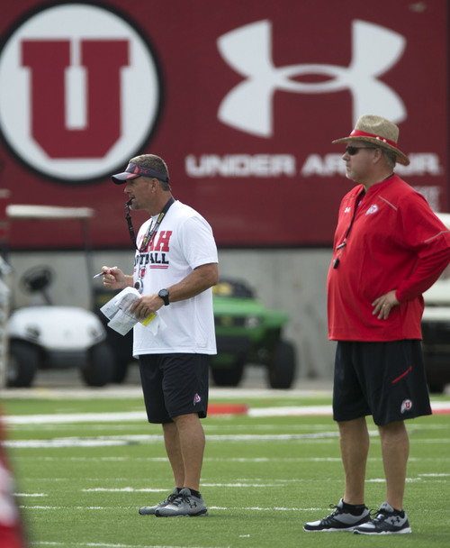 Steve Griffin     The Salt Lake Tribune  Utah head football coach Kyle Whittingham, left, and offensive coordinator Dave Christensen watch the offense during football practice at Rice-Eccles Stadium in Salt Lake City Monday, Aug. 4, 2014.