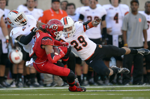 Chris Detrick  |  The Salt Lake Tribune Utah Utes wide receiver Dres Anderson (6) makes a catch past Idaho State Bengals Brandon Golden (5) and Idaho State Bengals defensive back Cody Sorensen (29) during the first half of the game at Rice-Eccles stadium Thursday August 28, 2014. Utah is winning the game 35-7.