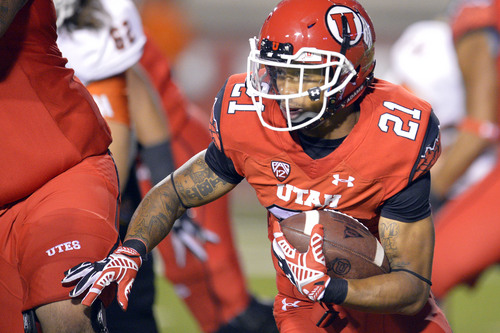Chris Detrick     The Salt Lake Tribune Utah Utes running back Troy McCormick (21) runs the ball during the second half of the game at Rice-Eccles stadium Thursday August 28, 2014. Utah defeated Idaho State 56-14.
