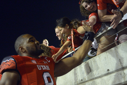 Chris Detrick  |  The Salt Lake Tribune Utah Utes defensive end Nate Orchard (8) greets fans after the game at Rice-Eccles stadium Thursday August 28, 2014. Utah defeated Idaho State 56-14.
