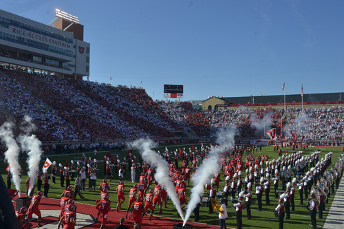 Chris Detrick  |  The Salt Lake Tribune The Utah football team runs onto the field before the game against Idaho State Bengals at Rice-Eccles stadium Thursday August 28, 2014. Utah is winning the game 35-7.
