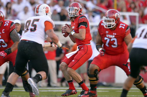 Chris Detrick     The Salt Lake Tribune Utah Utes quarterback Travis Wilson (7) looks to pass the ball during the first half of the game at Rice-Eccles stadium Thursday August 28, 2014. Utah is winning the game 35-7.