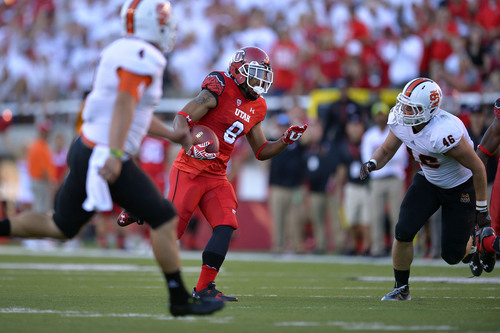 Chris Detrick  |  The Salt Lake Tribune Utah Utes wide receiver Kaelin Clay (8) runs past Idaho State Bengals C.J. Reyes (4) and Idaho State Bengals linebacker Mitch Beckstead (46) for a touchdown during the first half of the game at Rice-Eccles stadium Thursday August 28, 2014. Utah is winning the game 35-7.