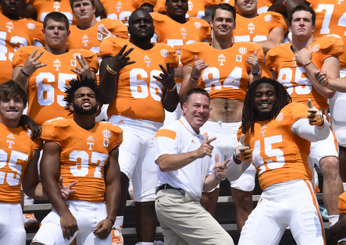University of Tennessee coach Butch Jones poses with players including Brian Randolph (37) and A.J. Johnson (45) during football media day Thursday, Aug. 14, 2014, in Knoxville, Tenn. (AP Photo/The Knoxville News Sentinel, Amy Smotherman Burgess)