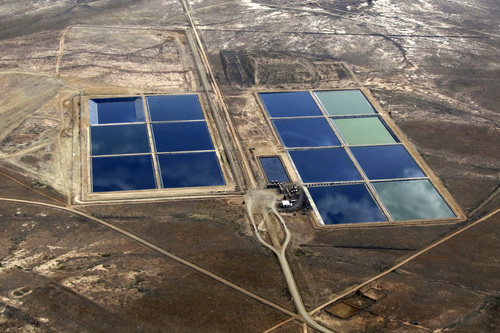 "(Courtesy Living Rivers)  Danish Flats Environmental Services operates Utah's largest pond farm, pictured here near Cisco, for handing produced water from oil and gas wells.  After years of claiming the ponds' emissions were ""de minimis,"" the company belatedly acknowledged this complex of five-acre ponds and tanks is a major source of hazardous air pollutants and volatile organic compounds. Utah regulators this month issued an air-quality permit for the facility this month after near six years of operation."