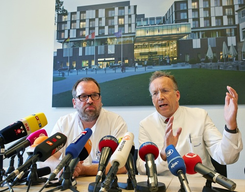 The doctor helping oversee the treatment, Stefan Schmiedel,, left, and  Internal Medicine  Director of the University Medical Center Hamburg-Eppendorf,  Ansgar Lohse, attend a press conference in the hospital in Hamburg, Wednesday Aug. 27, 2014. A scientist who was infected with Ebola while working for the World Health Organization in Sierra Leone began receiving treatment Wednesday in a Hamburg hospital after being flown overnight to Germany. The man, whose name and condition are being withheld for patient privacy reasons, is being treated at the U.N. agency's request in city's University Medical Center Hamburg-Eppendorf, home to the well-known Bernhard-Nocht Clinic for Tropical Medicine.   (AP Photo/dpa, Georg Wendt)