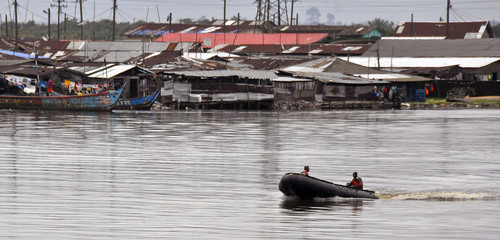 Liberian soldiers patrol the seaside of West Point by boat, an area that has been hit hard by the Ebola virus, with local residents not allowed to leave the West Point area,  as government forces clamp down on movement to prevent the spread of Ebola, in  Monrovia, Liberia, Wednesday, Aug. 27, 2014. Health officials in Liberia said the other two recipients of ZMapp in Liberia, a Congolese doctor and a Liberian physician's assistant, have recovered. Both are expected to be discharged from an Ebola treatment center on Friday, said Dr. Moses Massaquoi, a Liberian doctor with the treatment team. (AP Photo/Abbas Dulleh)