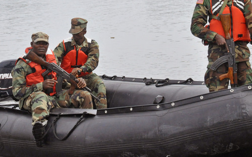 Armed Liberian soldiers patrol the seaside of West Point, an area that has been hit hard by the Ebola virus, with local residents not allowed to leave the West Point area,  as government forces clamp down on movement to prevent the spread of Ebola, in  Monrovia, Liberia, Wednesday, Aug. 27, 2014. Health officials in Liberia said the other two recipients of ZMapp in Liberia, a Congolese doctor and a Liberian physician's assistant, have recovered. Both are expected to be discharged from an Ebola treatment center on Friday, said Dr. Moses Massaquoi, a Liberian doctor with the treatment team. (AP Photo/Abbas Dulleh)