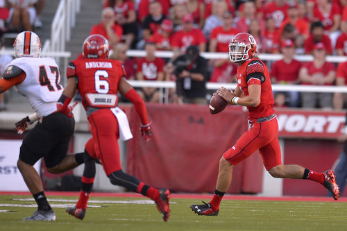 Chris Detrick  |  The Salt Lake Tribune Utah Utes quarterback Travis Wilson (7) looks to pass the ball during the first half of the game at Rice-Eccles stadium Thursday August 28, 2014. Utah is winning the game 35-7.