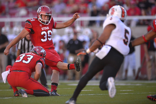 Chris Detrick  |  The Salt Lake Tribune Utah Utes place kicker Andy Phillips (39) kicks an extra point during the first half of the game at Rice-Eccles stadium Thursday August 28, 2014. Utah is winning the game 35-7.