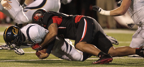 California quarterback Zach Maynard (15) is sacked by Utah defensive tackle Tenny Palepoi (91) in the first quarter during an NCAA college football game Saturday, Oct. 27, 2012, in Salt Lake City.  (AP Photo/Rick Bowmer)