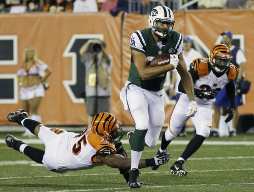 New York Jets tight end Jace Amaro (88) is pursued by Cincinnati Bengals defensive tackle Devon Still (75) in the second half of an NFL preseason football game, Saturday, Aug. 16, 2014, in Cincinnati. (AP Photo/Tony Tribble)