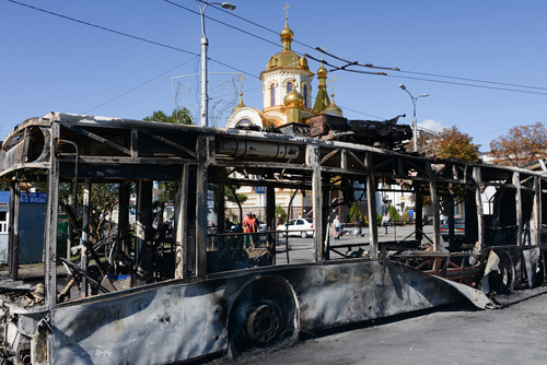 A burned trolleybus is seen near Donetsk train station after shelling, Donetsk, Ukraine, Saturday, Aug.30, 2014. Heavy shelling from an unknown source hit a railway station and a nearby market on Friday evening in Donetsk, the largest rebel-held city in eastern Ukraine, an OSCE observer said at the site. (AP Photo/Mstyslav Chernov)