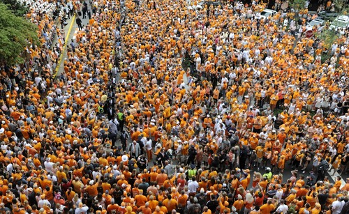 Tennessee fans surround football players during the Vol Walk before an NCAA college football game against Utah State, Sunday, Aug. 31, 2014, in Knoxville, Tenn. (AP Photo/The Knoxville News Sentinel, Adam Lau)