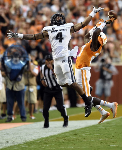 Tennessee defensive back Justin Coleman (27) breaks up a pass intended for Utah State wide receiver Hunter Sharp (4) during their NCAA college football game at Neyland Stadium, Sunday, Aug. 31, 2014 in Knoxville, Tenn. Coleman was called for pass interference during the play.   (AP Photo/Knoxville News Sentinel, Saul Young)
