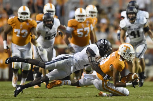 Tennessee wide receiver Josh Malone (3) catches a reception against Utah State during the first half at Neyland Stadium, Sunday, Aug. 31, 2014 in Knoxville, Tenn.  (ADAM LAU/NEWS SENTINEL)