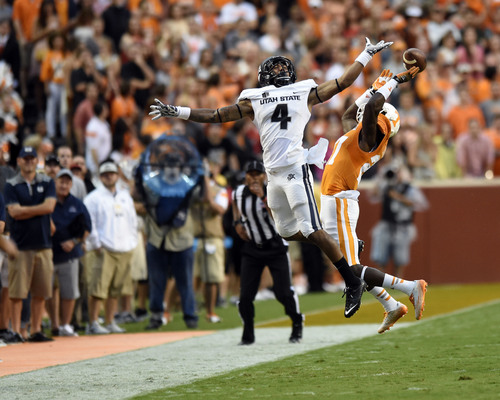 Tennessee defensive back Justin Coleman (27) breaks up a pass intended for Utah State wide receiver Hunter Sharp (4) during the game against Utah State at Neyland Stadium, Sunday, Aug. 31, 2014 in Knoxville, Tenn. Coleman was called for pass interference during the play.   (SAUL YOUNG/NEWS SENTINEL)