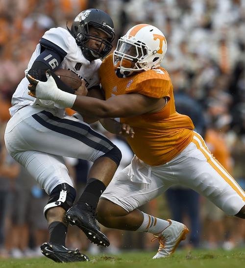 Tennessee defensive end Derek Barnett (9) sacks Utah State quarterback Chuckie Keeton (16) at Neyland Stadium, Sunday, Aug. 31, 2014 in Knoxville, Tenn.  (AMY SMOTHERMAN BURGESS/NEWS SENTINEL)