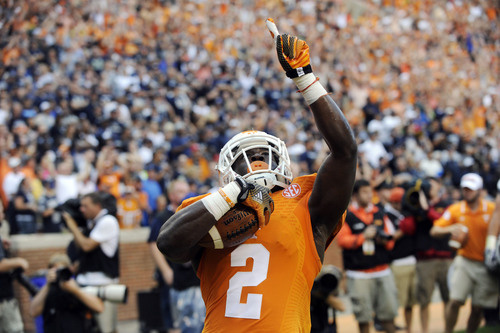 Tennessee wide receiver Pig Howard celebrates after scoring the first touchdown of the game against Utah State during their NCAA college football game at Neyland Stadium, Sunday, Aug. 31, 2014 in Knoxville, Tenn.  (AP Photo/Knoxville News Sentinel, Saul Young)