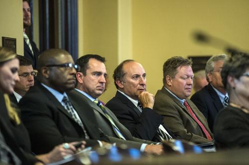 Chris Detrick     The Salt Lake Tribune UTA Board Chair Greg Hughes UTA, center left, and General Manager Mike Allegra, left, listen during a Audit Subcommittee of the Legislative Management Committee Tuesday August 26, 2014.