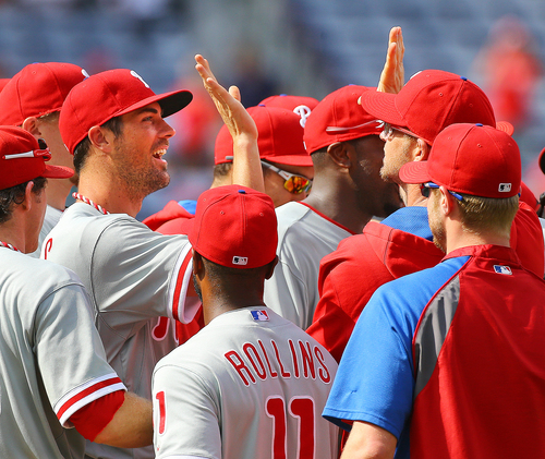 Philadelphia Phillies Cole Hamels,left, and teammates celebrate a 7-0 no hitter against the Atlanta Braves in a baseball game in Atlanta on Monday, Sept. 1, 2014. Hamels went six innings and relievers Jake Diekman, Ken Giles and closer Jonathan Papelbon combined to no-hit the Braves.     (AP Photo/Atlanta Journal-Constitution, Curtis Compton)  MARIETTA DAILY OUT; GWINNETT DAILY POST OUT; LOCAL TELEVISION OUT; WXIA-TV OUT; WGCL-TV OUT