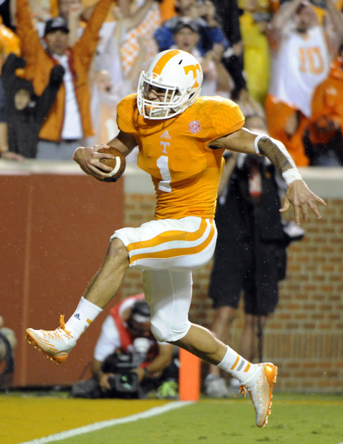 Tennessee running back Jalen Hurd (1) scores a touchdown against Utah State during their NCAA college football game at Neyland Stadium, Sunday, Aug. 31, 2014 in Knoxville, Tenn.  Tennessee won 38-7.  (AP Photo/Knoxville News Sentinel, Michael Patrick)
