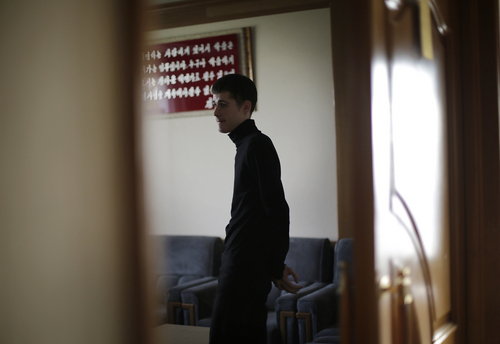 Mathew Miller, an American detained in North Korea, waits in a room after speaking to the Associated Press, Monday, Sept. 1, 2014 in Pyongyang, North Korea. North Korea has given foreign media access to three detained Americans who said they have been able to contact their families and watched by officials as they spoke, called for Washington to send a representative to negotiate for their freedom. (AP Photo/Wong Maye-E)