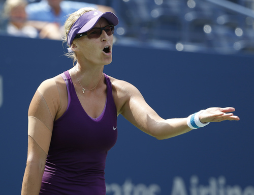 Mirjana Lucic-Baroni, of Croatia, reacts after shot against Sara Errani, of Italy, during the fourth round of the 2014 U.S. Open tennis tournament, Sunday, Aug. 31, 2014, in New York. (AP Photo/Kathy Willens)