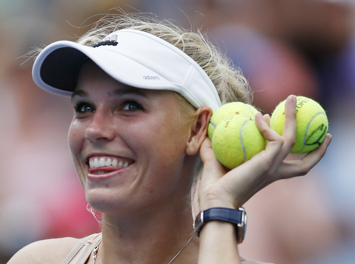 Caroline Wozniacki, of Denmark, plays to the crowd after defeating Maria Sharapova, of Russia, in their fourth round match of the 2014 U.S. Open tennis tournament, Sunday, Aug. 31, 2014, in New York. (AP Photo/Kathy Willens)