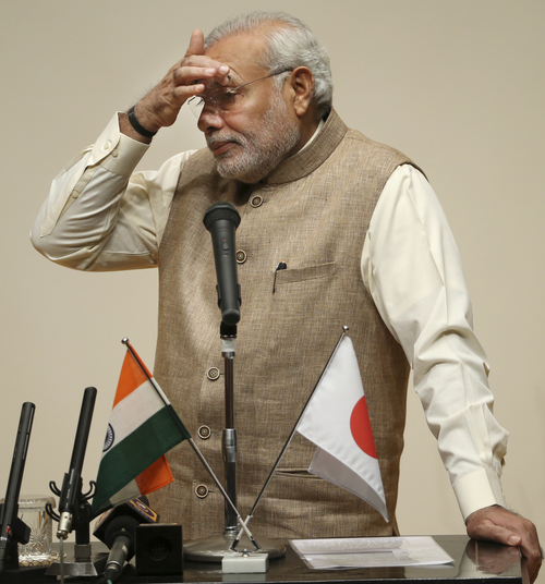 Indian Prime Minister Narendra Modi pauses while speaking during his lecture at the University of the Sacred Heart in Tokyo, Tuesday, Sept. 2, 2014. Modi is currently on a five-day visit to Japan. (AP Photo/Koji Sasahara)