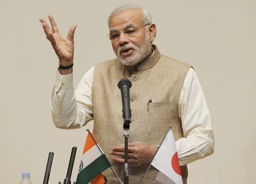 Indian Prime Minister Narendra Modi delivers a speech during his lecture at the University of the Sacred Heart in Tokyo, Tuesday, Sept. 2, 2014. Modi is currently on a five-day visit to Japan. (AP Photo/Koji Sasahara)