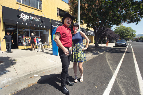 Steve Griffin     The Salt Lake Tribune Michael Sanders, owner of Now and Again, and, Amy Leininger, owner of Q Clothing, stand in the street outside their stores on 300 South near 200 in Salt Lake City, on Friday. Protected bike lanes from 600 East to 300 West will require the loss of about one-third of curbside parking because angle parking will change to parallel parking to make room for the bike lanes. Stores owners like Sanders and Leininger will loose a majority of the parking in front of their stores.