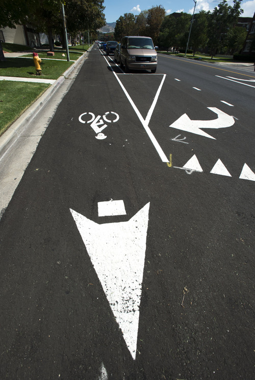 Steve Griffin     The Salt Lake Tribune Traffic information is painted on 300 South near 200 in Salt Lake City, on Friday where protected bike lanes from 600 East to 300 West will require the loss of about one-third of curbside parking because angle parking will change to parallel parking to make room for the bike lanes.