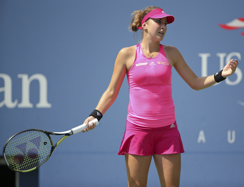 Belinda Bencic, of Switzerland, reacts after a shot against Peng Shuai, of China, during the quarterfinals of the 2014 U.S. Open tennis tournament, Tuesday, Sept. 2, 2014, in New York. (AP Photo/Mike Groll)