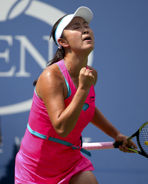 Peng Shuai, of China, reacts after a shot against Belinda Bencic, of Switzerland, during the quarterfinals of the 2014 U.S. Open tennis tournament, Tuesday, Sept. 2, 2014, in New York. (AP Photo/Mike Groll)